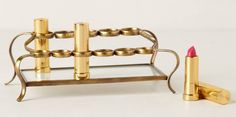 A tiered brass cosmetic holder for anyone who's obsessed with lipstick.