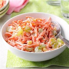 Pina Colada Carrot Salad Recipe -This carrot salad with pina colada yogurt, green grapes and macadamia nuts has a tropical theme. Just mix and chill out. —Emily Tyra, Milwaukee, Wisconsin