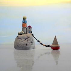 Little grey lighthouse with house and miniature boat , ceramic lighthouse sculpture , hand made ceramics and pottery home decor Israeli art