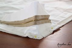 DIY:  How To Sew Cushion Slipcovers -  excellent tutorial with tons of pictures. She also has a tutorial to make sofa slipcovers & pleated chair covers.