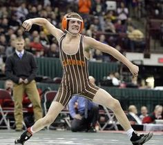 Claymont's Tyler Warner celebrates his victory over Napoleon's Seth Beard for the Division II 106-pound state title Saturday in Columbus. Warner is Claymont's seventh state champion and first since 2009.