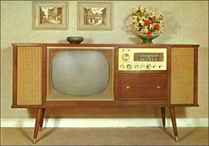 This T.V. Is almost identical to the Curtis Mathis set my grandparents had. It featured a radio and a pull-out drawer with a record player inside.