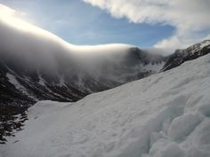 Cloud overhangs the edge of Coire An T Sneachda in The Cairngorms. Bespoke Winter Climbing Course, February 2012.