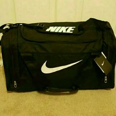 "Nike Duffel Bag NWT ****Price is firm will not respond to offers. If you want discount I would suggest bundling with another item to get 10% discoint***  Size medium. Has 2 side compartments. Tough 600D PolyesterWet/Dry Separation  Adjustable, padded shoulder strap  Screened Swoosh design trademark  24.5"" x 13"" x 12"" Nike Bags Travel Bags"
