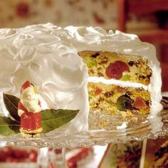 Filled with candied fruits and nuts, then topped with snowy-white frosting, this cake is a Christmas dessert recipe that will be memorable. Christmas Desserts, Christmas Treats, Christmas Baking, Royal Christmas, Christmas Cakes, Christmas Fruitcake, Christmas Time, Cupcake Recipes, Cupcake Cakes