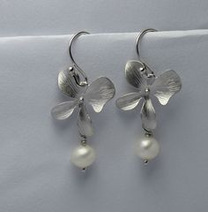pearl and orchid earring . dangle orchid earring . by arbjewelry