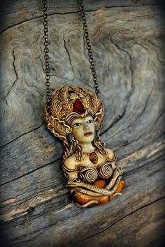 Aztec Goddess of Beauty Hand Sculpted clay pendant