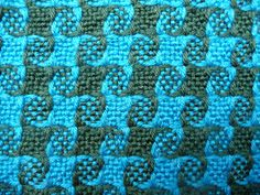 "Thanks to Jeen on Ravelry , I found a ""recipe"" for 8-shaft weaving on a rigid heddle loom.    This is Pinwheel Weave.  Yes, it is very cool...."