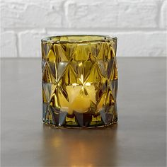 Free Shipping.  Shop betty tea light candle holder.   A modern angle on a retro classic, this multifaceted glass form illuminates the golden glow of amber in every direction.  Candle sold separately.