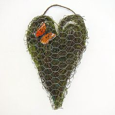 Make a country chic chicken wire heart. Great door or wall decor.