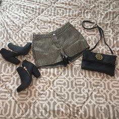 NWT Black and Gold Dressy Shorts! Brand new, with tags! Never worn! Beautiful black and gold shorts that would look great with black tights and booties! **NOT Urban, just tagged for exposure. Purchased from a boutique in Dallas. Smoke free and pet free home! Make me an offer☺️ Urban Outfitters Shorts