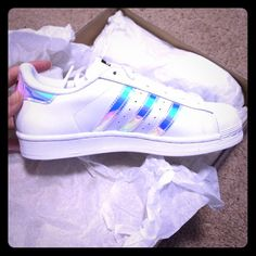 Metallic New Adidas original superstar white Sexy Brand new women's 8= big kids 6 I waited a month for these and bought two pairs to make sure they fit, selling this one that was too big. I'm a 7.5 and wear 5.5 big kids perfect :) Adidas Shoes Sneakers