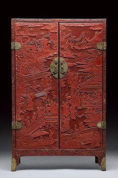 A rare and important red lacquered cabinet