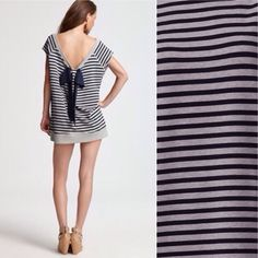 AIKO Stripe Tunic Dress Best in Tops Party HOST PICK!!!  Cute AIKO wide-neck striped sweater tunic with a scoop back and draped bow.  Proudly made in the USA.  96% cotton and 4% spandex.  Bundle this item along with 2 or more items from my closet and save an extra 10% off!   Feel free to comment below if you have any questions :)  Thanks! AIKO Tops Tunics