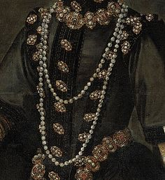 This shows the jewels and the various bodice materials in the Coello portrait of Infanta Catalina from about 1585. Her bodice is decorated with vertical ribs of parallel contrasting black material. The horizontal edges of her over-sleeves are also decorated with ribs of contrasting material, center-left side.