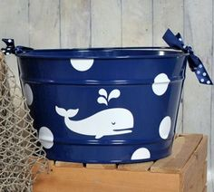 This preppy whale bucket is perfect for the beach loving baby. With classic and preppy style and colors, you can show off this bucket anywhere you choose. Store toys and books in the playroom, or in the nursery filled with diapers and essentials! $48.99