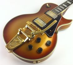 RARE Vintage 1982 Gibson Les Paul Custom Goldburst. RESEARCH #DdO:) - https://www.pinterest.com/DianaDeeOsborne/instruments-for-joy/ - More than just a pretty picture! Super cool and rare 1982 Gibson Les Paul Custom Goldburst. They finished these Goldburst guitars in limited quantities. Hard to find. Hint: Even the silver burst is $4,200. Although the Bigsby vibrato is not original, it adds a nice elegant touch to look overall vibe.