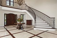 Traditional Staircase with High ceiling, Hardwood floors, Chandelier
