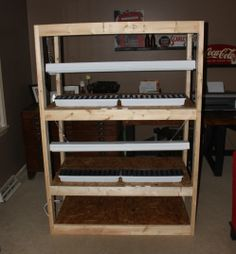 Our seed-starting rack stand - room for over 500 seedlings!