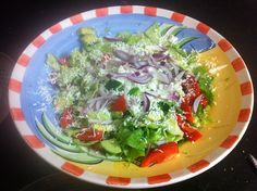 Salad of cos lettuce, cucumber, tomato, avocado, red onion topped with grated parmesan cheese!