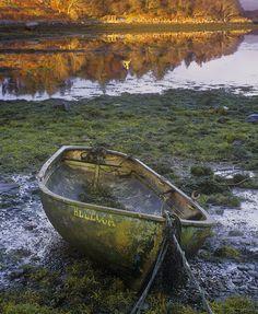 row boat adrift.