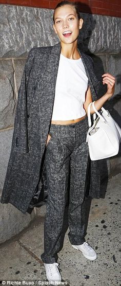 9f14b534c8 Karlie Kloss left Marc Jacobs in grey suit trousers and a matching overcoat  http