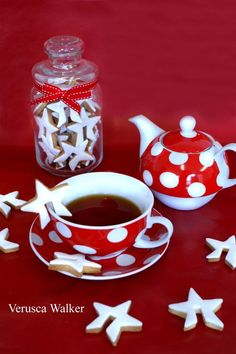 Cup-hanging cookie cutters. The cutters come in a set of four (either stars, hearts, butterflies, and flowers) and have a little slit in them to allow you to hang the cookie on the rim of...