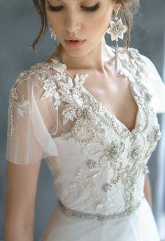 Such unique and gorgeous wedding dress! - www.weddingbandsforboth.com