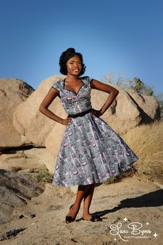 Heidi Dress in Birdcage Print - Our Heidi is the cute sister to our Natasha dress. Perfect for any season, this swing dress has a slightly shorter hemline, an absurdly flattering gathered bustline, and contrast trim. Made from the highest quality stretch sateen in Pinup Couture's custom vintage birdcage print.