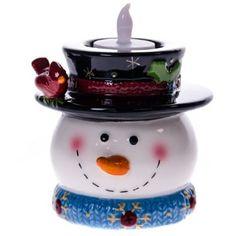 Snowman Tealight Candle Holder http://shop.crackerbarrel.com/Snowman-Tealight-Candle-Holder/dp/B00EJT0EJU
