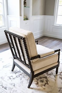 Living room spindle arm chair   this solid birch frame springs to life with a dynamic, elaborately carved spindle design. Distinguished by its bead-style detail, the chair came into favor during the 17th century and has graced interiors ever since. Our version presents an espresso finish and features arm panels and cushions upholstered in a cotton linen blend. Elegant from front to back, this seat is a bona fide beauty.