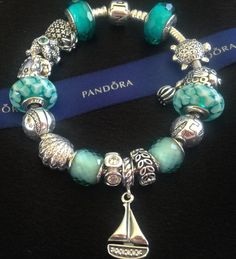 Image result for PANDORA Silver Murano Glass Teal Lattice Charm
