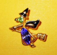 Tiny Vintage Rhinestone Flying Witch Lapel Pin by baublology