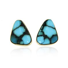 18k Gold Earrings featuring Tibetian Turquoise in a rounded triangle shape. Vibrant turquoise blue with black matrix - a custom design by MMG, one of our favorite vendors from the Tucson Gem and Miner