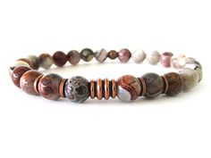 Cool and hip men's bracelet featuring 8mm Mexican Laguna lace agate beads and antiqued copper accent beads.