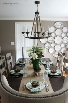 Dining room    wingback end chars    ladder back side chairs    rope chandelier    burlap runner    plate wall
