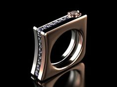 A contemporary white and rose gold diamond and labrodrite gentlemans ring