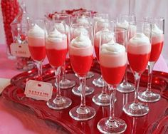 pudding parfait topped with whipped cream in champagne glasses.