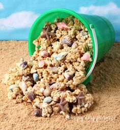 Beach Party Popcorn - Peanut Butter White Chocolate Popcorn Sprinkled with Sandy Cookie Crumbs and Chocolate Sea Shells