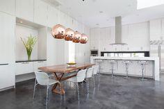 Houston-based designer Laura Umansky - Laura U Interior Design - the space is punctuated with four (four!) copper pendants