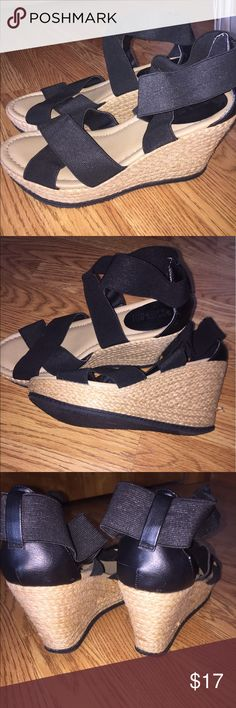 Kenneth Cole Reaction Black & Tan Wedges Good condition Kenneth Cole Reaction wedges. They have been worn a few times but have a ton of life left. Super comfy. The size tag has been removed but they are an 8.5-9, I am fairly certain they are a 9 though. The straps are stretchy so they are very versatile. Kenneth Cole Reaction Shoes Wedges