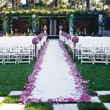 Wedding Aisle with purple flower petals.