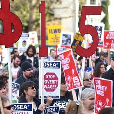 Supporters of higher wages for Oregon's low-paid workers swarmed the state Capitol steps today, loudly chanting