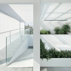 ReMIX+Studio's+Shunyi+House+extension+features+louvred+cladding+and+an+all-white+interior