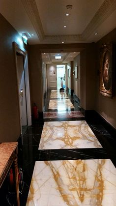 stainless hallway in a hotel Sparkling Drinks, Cleaning Agent, Stone Flooring, Home Decor, Decoration Home, Room Decor, Home Interior Design, Home Decoration, Interior Design
