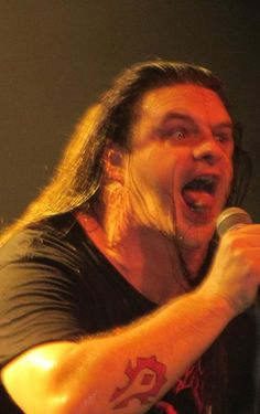 George 'Corpsegrinder' Fisher of Cannibal Corpse mid-growl and-or summoning demons [1389x2213]