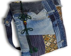 One-of-a-kind. Convenient and stylish. Pretty cool recycled jeans patchwork bag can be worn two ways - as a clutch and a wrist bag. Fully lined (kimono: