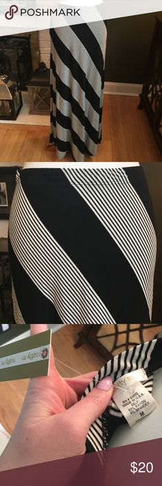 Maxi Skirt by Matty M This black and white striped maxi skirt is by Matty M. It is a size medium and it is made in the USA out of 92% rayon and 8% spandex. The waistband is elastic. It measures roughly at 39 inches. It is in great condition. Matty M Skirts Maxi