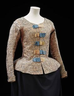 Woman's pink silk waistcoat with blue embroidery, English 1610-20. Waistcoats were worn with petticoats (skirts) and loose gowns over the top, accessorised with fine lace cuffs and ruffs or bands (collars). The waistcoat has been altered twice