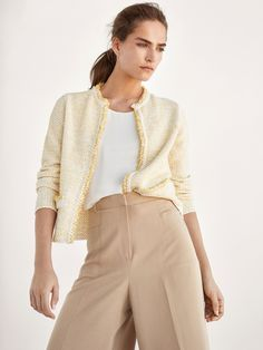Open embellished cardigan with frayed edges. Features a straight cut, round neck, two side pockets and long sleeves.